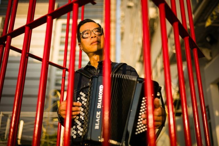 Kacey Wong performs in a 2018 art project called 'The Patriot' that protested the National Anthem Law