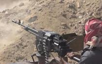 A grab from an AFPTV video shows a Yemeni pro-government fighter firing at positions of the Iran-backed Huthi rebels as they inch closer to the loyalists' last northern bastion, the strategic city of Marib, on September 27 (AFP/-)
