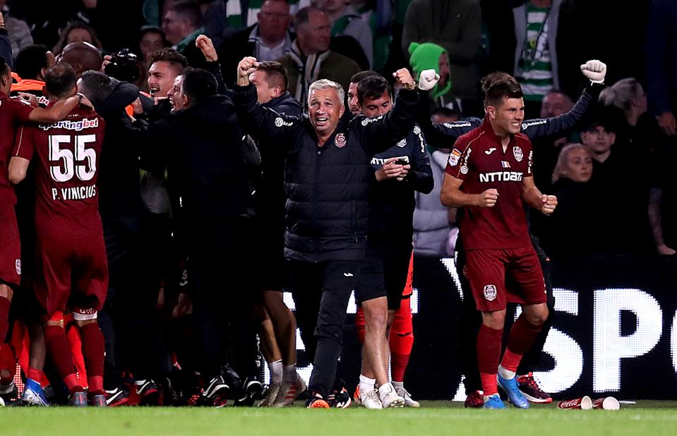 Cluj manager Dan Petrescu celebrates victory after the final whistle during the UEFA Champions League third qualifying round second leg match at Celtic Park, Glasgow. (Photo by Jane Barlow/PA Images via Getty Images)