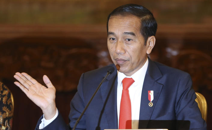 Indonesia President Joko Widodo gestures as he speaks during a press conference at the palace in Jakarta, Indonesia, Monday, Aug. 26, 2019. Indonesia's president has announced to relocate the country's capital from overcrowded, sinking and polluted Jakarta to East Kalimantan province. (AP Photo/Achmad Ibrahim)
