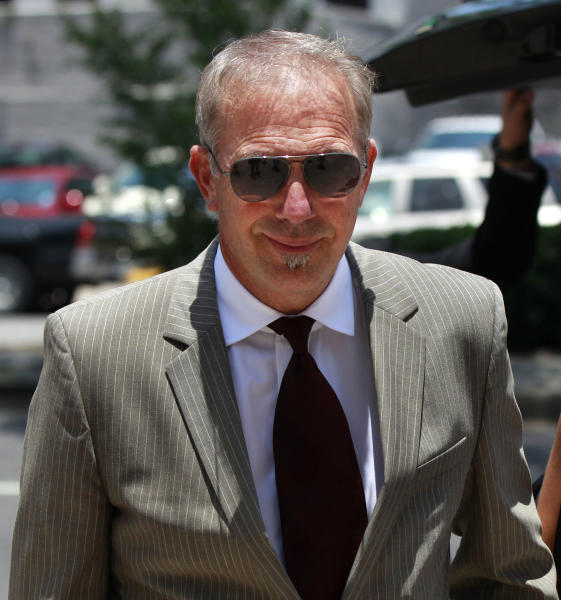 Kevin Costner, center, arrives at Federal Court on Thursday, June 14, 2012 in New Orleans. A jury is set to hear closing arguments in the trial for Stephen Baldwin's lawsuit against Costner over their multimillion dollar business dispute in the aftermath of the 2010 oil spill in the Gulf of Mexico. The lawsuit accuses Costner and Smith of duping Baldwin and friend Spyridon Contogouris over their investments in an oil cleanup device that BP used after the spill. (AP Photo/Gerald Herbert)