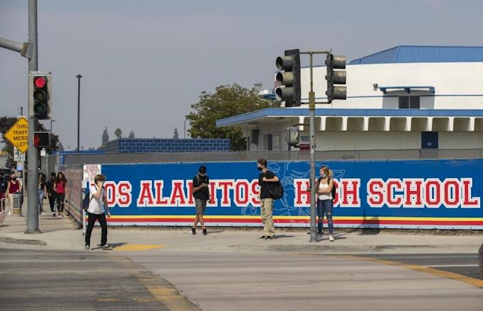 LOS ALAMITOS, CA - OCTOBER 05: Students leave campus after a day of in-class learning at Los Alamitos High School, Monday, Oct. 5, 2020 in Los Alamitos. Los Alamitos Unified School District reopened in September. (Allen J. Schaben / Los Angeles Times)