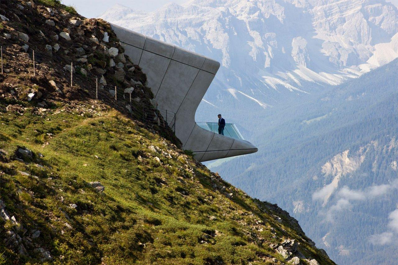 "<p>Hadid's <a href=""http://www.messner-mountain-museum.it/en/"">latest building</a>, completed in July 2015, pays homage to the courageous sport of mountain climbing with an equally daredevil design. Perched inside a mountain peak, visitors can bravely peer over the edge. <i>Photo: Inexhibit.com</i></p>"