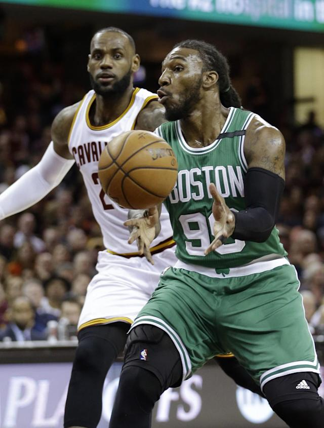 <p>Boston Celtics' Jae Crowder (99) passes against Cleveland Cavaliers' LeBron James (23) during the first half of Game 3 of the NBA basketball Eastern Conference finals, Sunday, May 21, 2017, in Cleveland. (AP Photo/Tony Dejak) </p>