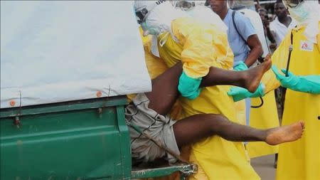 Video grab of health workers pushing an Ebola patient who escaped from quarantine from Monrovia's Elwa hospital, into an ambulance in the centre of Paynesville
