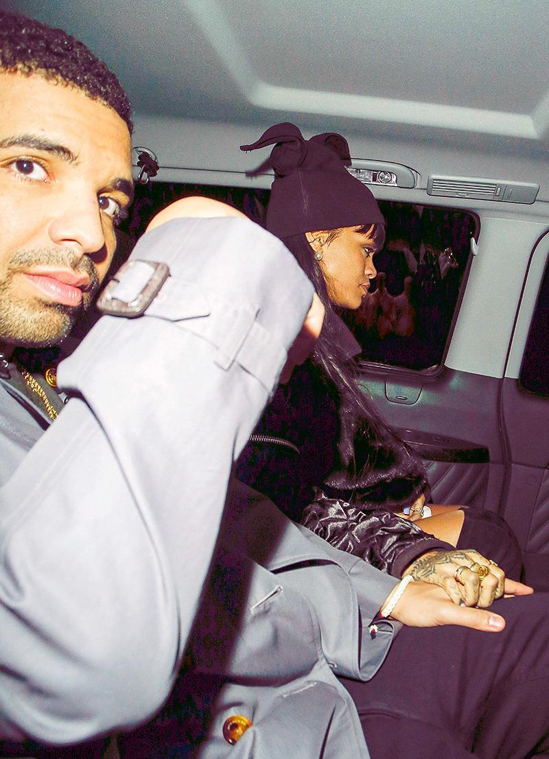 <p>Well, what do we have here? For the first time, Rihanna and Drake seemed to confirm their romance when they were caught holding hands in London. (Photo: AKM-GSI) </p>