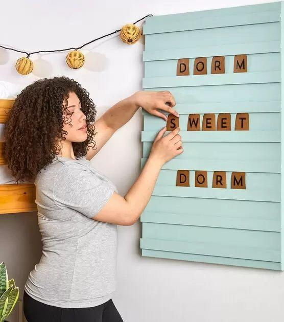 """<p>Letter boards always come in handy for those special milestone photos, but they all start to look the same. Give yours personality by making a DIY slatted board in a color that matches your room.</p><p><a href=""""https://go.redirectingat.com?id=74968X1596630&url=https%3A%2F%2Fwww.joann.com%2Fcotton-lanyard%2F0922188784P127.html&sref=https%3A%2F%2Fwww.goodhousekeeping.com%2Fhome%2Fcraft-ideas%2Fg22593259%2Fback-to-school-diy%2F"""" rel=""""nofollow noopener"""" target=""""_blank"""" data-ylk=""""slk:Get the tutorial at JOANN »"""" class=""""link rapid-noclick-resp""""><em>Get the tutorial at JOANN » </em></a></p>"""