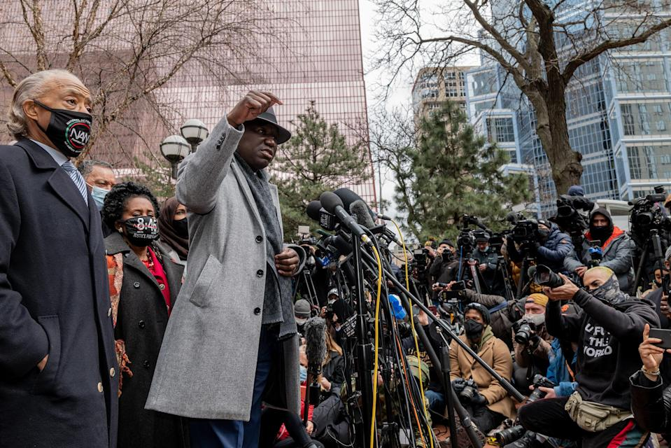 """Attorney Ben Crump speaks before the Rev. Al Sharpton and leads a prayer outside of the courthouse during closing arguments in the Chauvin trial in Minneapolis on April 19.<span class=""""copyright"""">Ruddy Roye for TIME</span>"""
