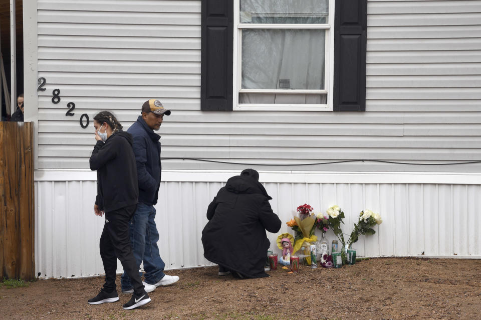 Mourners organize a memorial on Monday, May 10, 2021, outside a mobile home in Colorado Springs, Colo., where a shooting at a party Sunday took place. A shooting at a birthday party inside a trailer park home that killed six people before the gunman took his own life stunned a state weary of gun violence just weeks after another Colorado mass shooting killed 10 people. (AP Photo/Thomas Peipert)