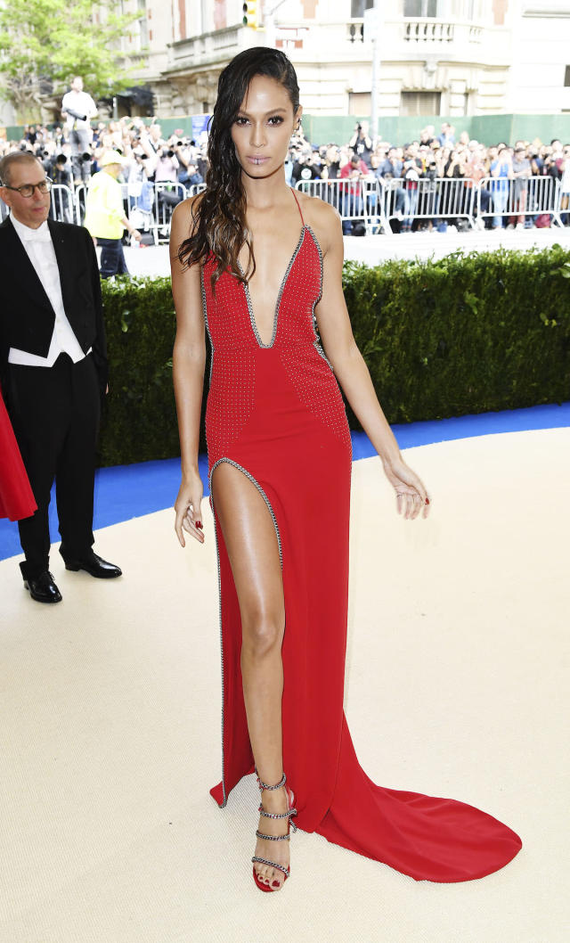<p>Model Joan Smalls wore a red gown with a plunging neckline from designer Topshop to the 2017 Met Gala. (Photo by Karwai Tang/WireImage) </p>