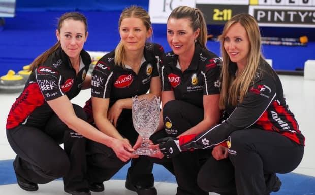 Ottawa's Rachel Homan, right, and rink pose with the Humpty's Championship Cup after defeating Switzerland's Silvana Tirinzoni 6-3 in the final on Monday. (Mike Cleasby/Grand Slam of Curling - image credit)