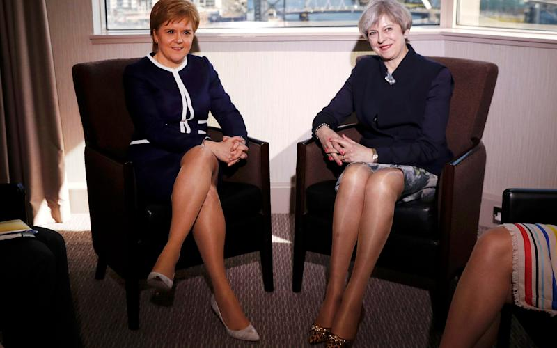 Britain's Prime Minister Theresa May and Scotland's First Minister Nicola Sturgeon - Credit: REUTERS/Russell Cheyne