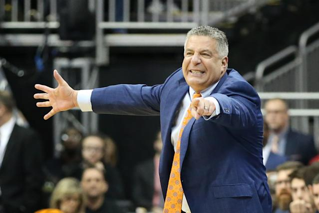 Auburn Tigers head coach Bruce Pearl points to his team during the NCAA basketball tournament. (Getty)