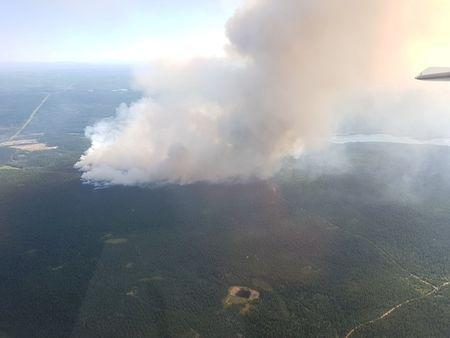 British Columbia wildfires seen near 100 Mile House in British Columbia, Canada in this handout photo obtained by Reuters July 7, 2017. BC Wildfire Service/Handout via REUTERS
