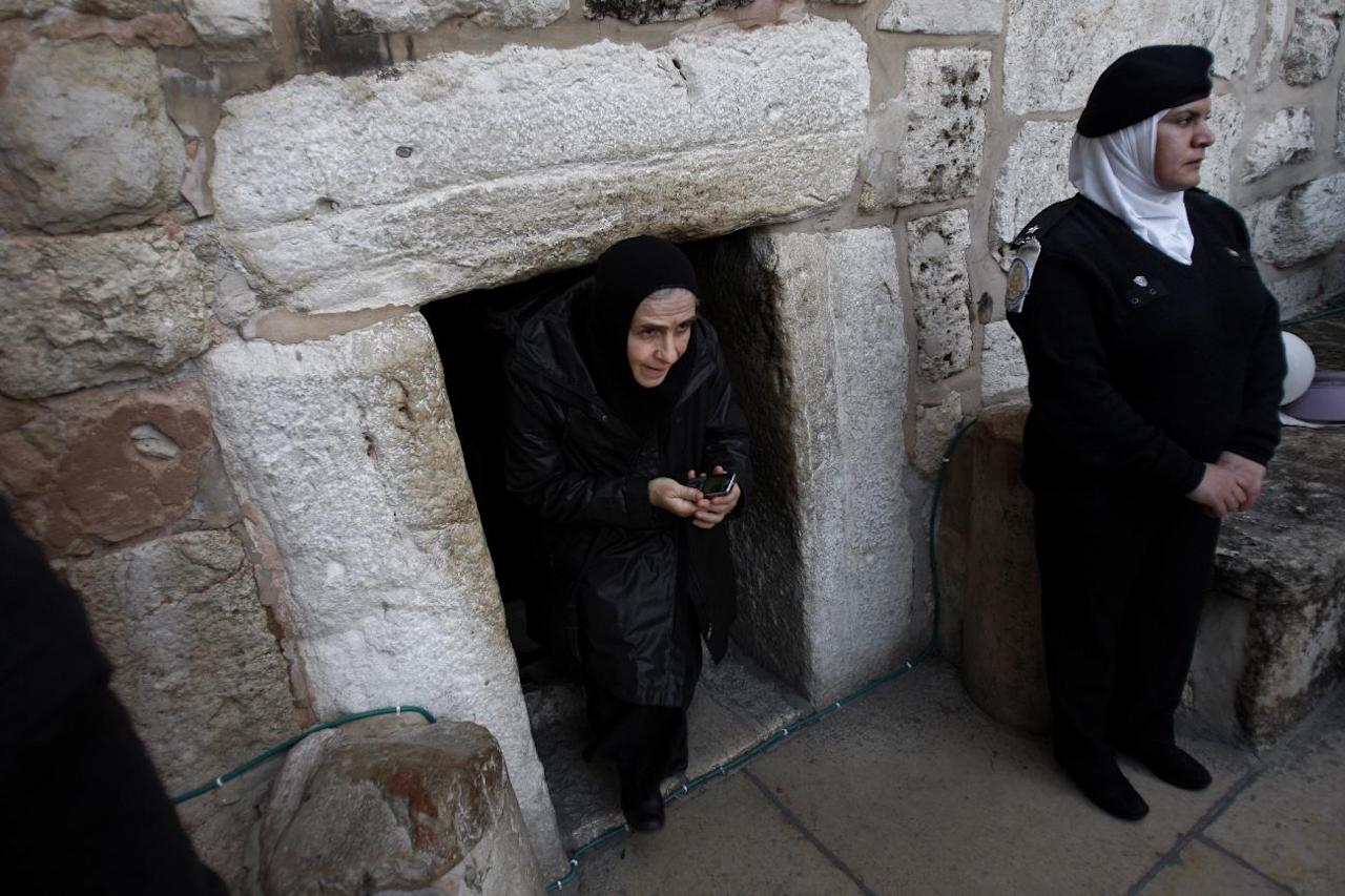 A Christian worshiper walks out of the Church of Nativity, traditionally believed by Christians to be the birthplace of Jesus Christ, in the West Bank town of Bethlehem, Monday, Dec. 24, 2012. Thousands of Christian worshippers and tourists arrived in Bethlehem on Monday to mark Christmas at the site where many believe Jesus Christ was born. (AP Photo/Adel Hana)