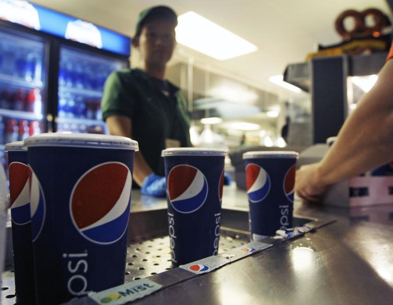 Soft drinks are on display during a baseball game between the New York Mets and the Washington Nationals Wednesday, Sept. 12, 2012, in New York. Health officials are expected to approve an unprecedented 16-ounce limit on sodas and other sugary drinks sold at restaurants, delis and movie theaters. (AP Photo/Frank Franklin II)