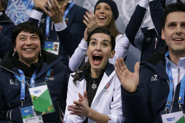 Valentina Marchei of Italy, centre, reacts in the results area after competing in the women's team free skate figure skating competition at the Iceberg Skating Palace during the 2014 Winter Olympics, Sunday, Feb. 9, 2014, in Sochi, Russia. (AP Photo/Darron Cummings, Pool)