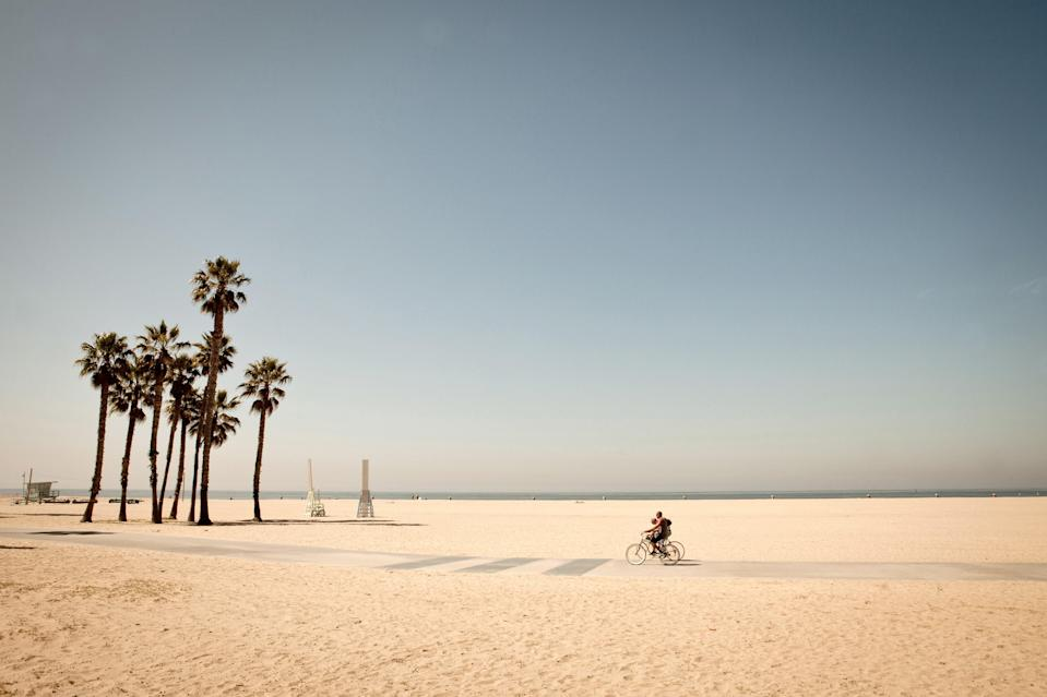 <p><strong>What kind of beach are we talking about?</strong><br> Venice Beach has a reputation for being a bit dirty, and given its location as one of LA's most centrally located beaches, it is, but it's a great beach. It's about a mile-and-a-half of silky sands and, of course, the Venice Beach Boardwalk, where street performers and vendors busk and sell their wares, muscle men lift huge amounts of weight, and subcultures congregate.</p> <p><strong>How accessible is it?</strong><br> It's usually possible to find free street parking, but on the weekends that could make for a long walk to the beach. Another option would be to park in a paid lot closer to the boardwalk—those are usually $10 for the day. Once you get there, cross the Boardwalk to the beach, which is very wide—it'll take a few minutes just to walk down to the water.</p> <p><strong>Decent services and facilities, would you say?</strong><br> There are all kinds of amenities at the various shops along the boardwalk, including surfboard, bicycle, and Segway rentals. If you're so inclined, Muscle Beach (an outdoor gym) is free, but daunting (there are usually some professional bodybuilders pumping iron there). There's tons of food around—we recommend the Sidewalk Cafe, which has ample seating, good food at a reasonable price (a simple burger is $11.45, while a Muscle Beach double patty burger is $17.95), and a great view of the Boardwalk for people watching.</p> <p><strong>How's the actual beach stuff—sand and surf?</strong><br> The water at Venice Beach isn't known for cleanliness, but if you're brave, there's no reason not to take a dip. On days with a bit of wind, you can usually spot some beginner surfers out in the water.</p> <p><strong>Can we go barefoot?</strong><br> Venice Beach has some nice sand that you can put down a blanket on and gaze out into the Pacific. Because it has a wide coastline, and it's a populous area, it's a famous jogging spot for barefoot running as well.</p> <p><strong>Anything s