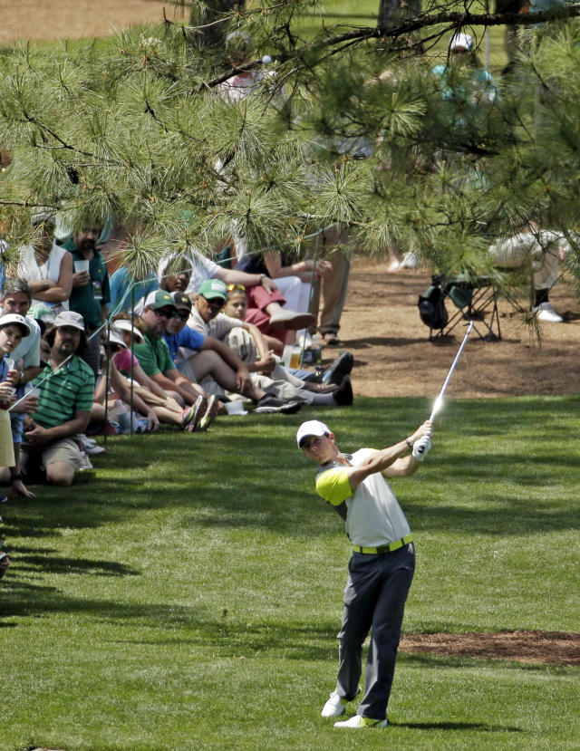 Rory McIlroy, of Northern Ireland, hits out of the rough off of the seventh fairway during the fourth round of the Masters golf tournament Sunday, April 13, 2014, in Augusta, Ga. (AP Photo/Chris Carlson)