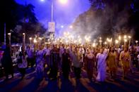 Bangladeshi secular activists take part in a torch-lit protest against the killing of blogger Niloy Chakrabarti, in Dhaka, in August 2015 (AFP Photo/Munir Uz Zaman)