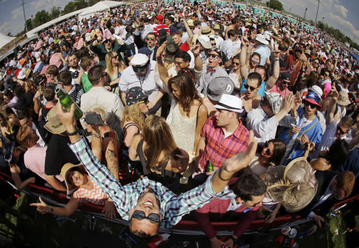 FILE - In this May 2, 2015, file photo taken with a fisheye lens, fans have fun in the infield before the 141st running of the Kentucky Derby horse race at Churchill Downs in Louisville, Ky. Next months Kentucky Derby will run without fans at Churchill Downs. The historic track cited rises in COVID-19 cases in the Louisville area. (AP Photo/Matt Slocum, File)