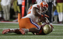 Clemson defensive lineman Christian Wilkins, left, tackles Boston College quarterback Anthony Brown during the first half of an NCAA college football game Saturday, Nov. 10, 2018, in Boston. Brown was injured on the play and left the game. (AP Photo/Elise Amendola)