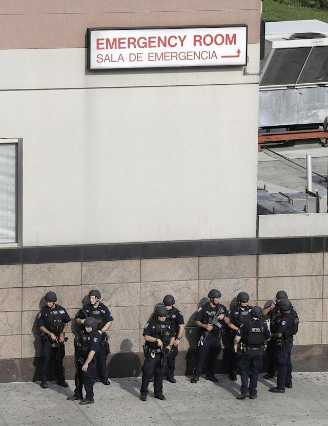 <p>Officials are gathered outside Bronx Lebanon Hospital Center after reports of a shooting, Friday, June 30, 2017, in New York. (AP Photo/Julio Cortez) </p>
