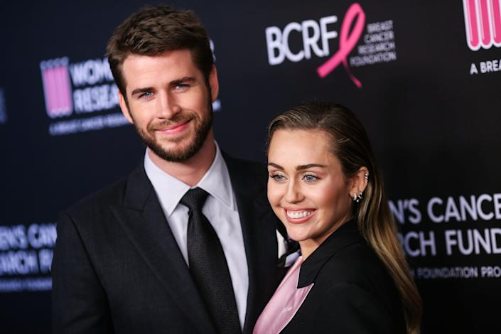 (FILE) Miley Cyrus and Liam Hemsworth Split. BEVERLY HILLS, LOS ANGELES, CALIFORNIA, USA - FEBRUARY 28: Actor Liam Hemsworth and wife/singer Miley Cyrus arrive at The Women's Cancer Research Fund's An Unforgettable Evening Benefit Gala 2019 held at the Beverly Wilshire Four Seasons Hotel on February 28, 2019 in Beverly Hills, Los Angeles, California, United States. (Photo by Xavier Collin/Image Press Agency/Sipa USA)