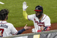 Atlanta Braves' Marcell Ozuna celebrates after a home run against the Los Angeles Dodgers during the fourth inning in Game 4 of a baseball National League Championship Series Thursday, Oct. 15, 2020, in Arlington, Texas. (AP Photo/Tony Gutierrez)