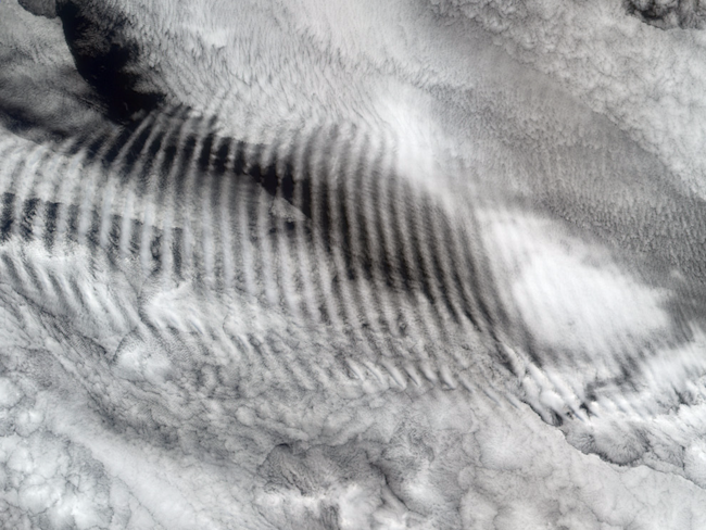 earth gravity waves clouds nasa earth observatory PIA04349_lrg