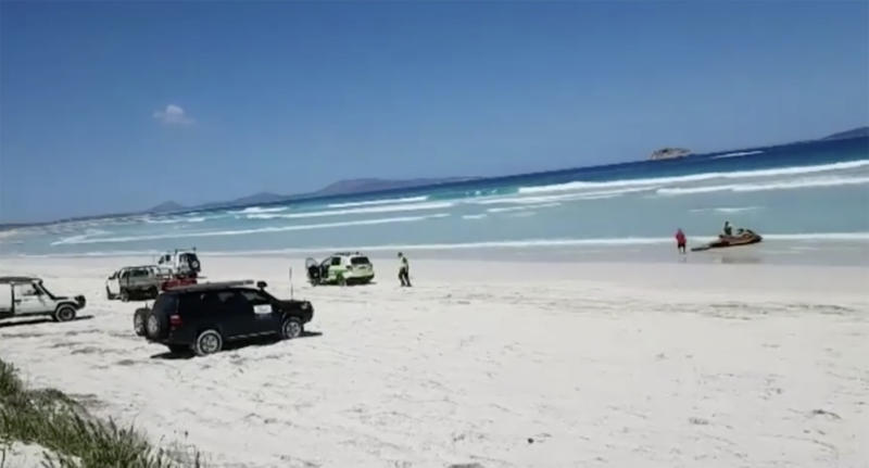 Emergency services at the scene of a fatal shark attack near Wylie Bay in Western Australia.