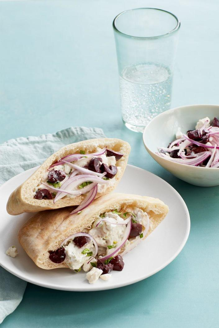 """<p>Store-bought rotisserie chicken gets a second life with these chicken salad sandwiches.</p><p><a href=""""https://www.womansday.com/food-recipes/food-drinks/recipes/a58990/mediterranean-chicken-salad-sandwiches-recipe/"""" rel=""""nofollow noopener"""" target=""""_blank"""" data-ylk=""""slk:Get the Mediterranean Chicken Salad Sandwiches recipe."""" class=""""link rapid-noclick-resp""""><u><u><em>Get the Mediterranean Chicken Salad Sandwiches recipe. </em></u></u></a></p>"""