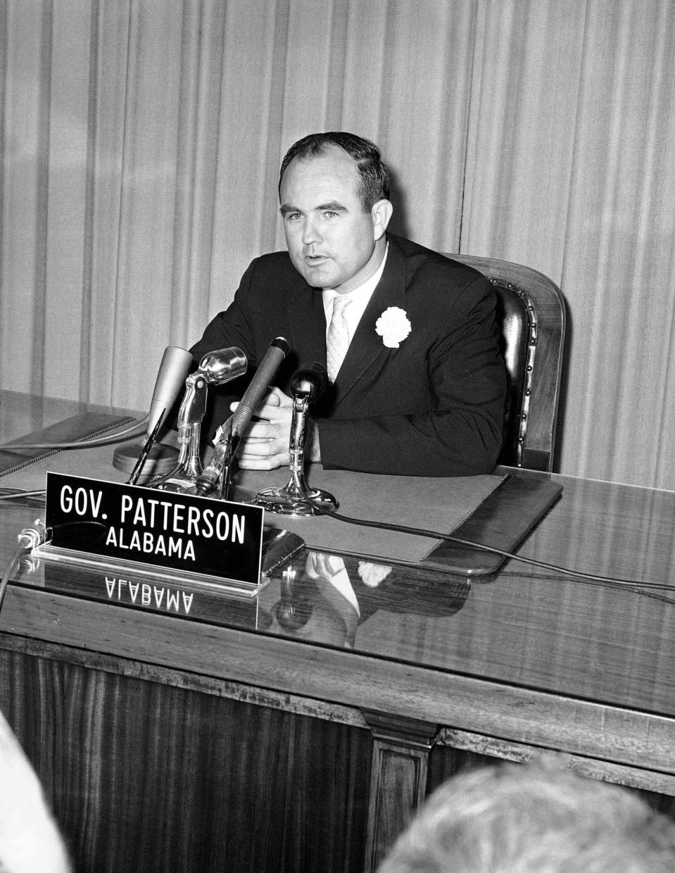 File- This May 23, 2961, file photo shows Alabama Gov. John Patterson telling news conference in Montgomery, Ala., that the federal government is responsible for rioting in the capital city. Patterson, who entered politics as a reformer after his father's assassination but was criticized for failing to protect the Freedom Riders from angry white mobs, has died. He was 99. He died Friday, June 4, 2021, his daughter, Barbara Patterson Scholl confirmed Saturday, June 5, 2021. She said funeral arrangements are pending. (AP Photo/Horace Cort, File )
