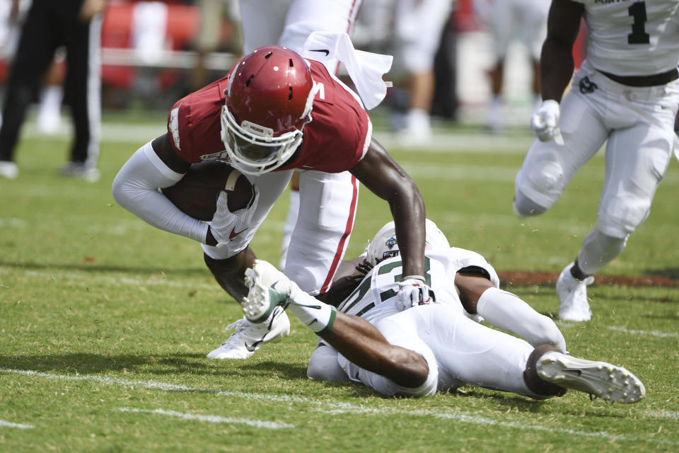 Arkansas receiver Mike Woods tries to get past Portland State defender Montre Brown in the first half of an NCAA college football game, Saturday, Aug. 31, 2019 in Fayetteville, Ark. (AP Photo/Michael Woods)