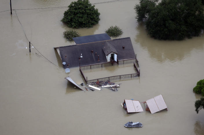 <p>A home is surrounded by floodwaters from Tropical Storm Harvey Tuesday, Aug. 29, 2017, in Houston. (Photo: David J. Phillip/AP) </p>