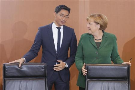 German Chancellor Merkel and Economy Minister Roesler arrive for weekly cabinet meeting in Berlin