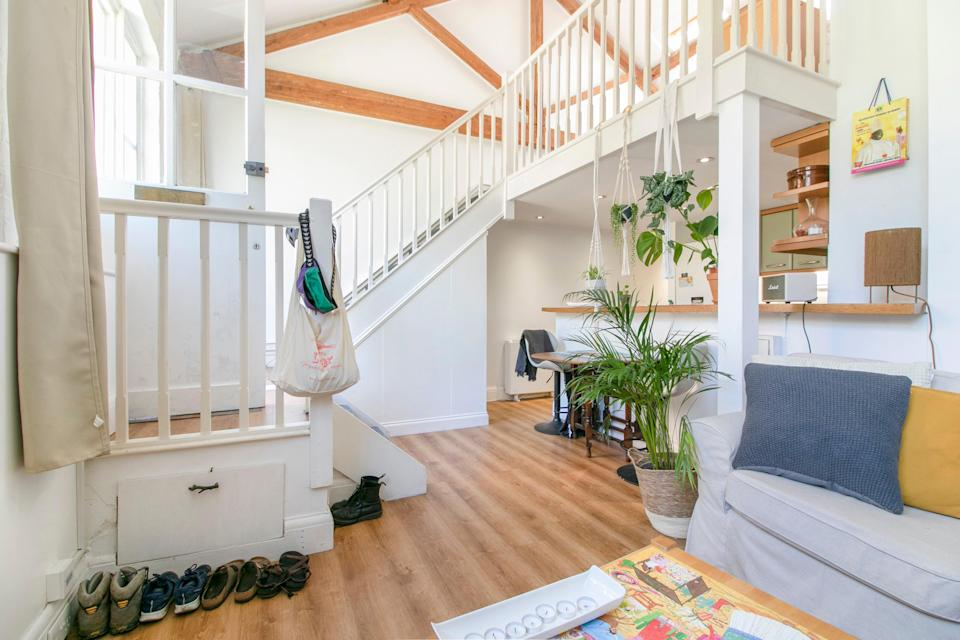 The cottage has a mezzanine bedroom over the open-plan living space and kitchen (Stirling Ackroyd)