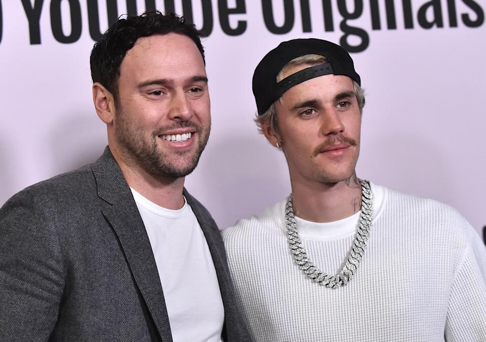 "Scooter Braun and Justin Bieber arrive for YouTube Originals' ""Justin Bieber: Seasons"" premiere on January 27, 2020. (Photo by Lisa O'Connor/AFP via Getty Images)"