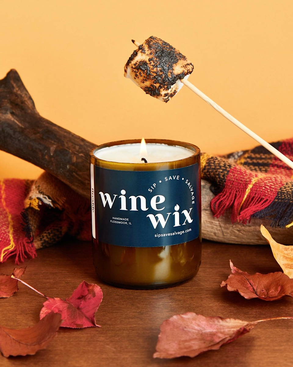 """<h3>Wine Wix Fireside Candle</h3><br>This handmade soy candle combines notes of smoke and wood into a warm mix of clove, amber, sandalwood, and patchouli all wrapped up in a repurposed wine bottle.<br><br><strong>Wine Wix</strong> Fireside Candle, $, available at <a href=""""https://go.skimresources.com/?id=30283X879131&url=https%3A%2F%2Fwww.etsy.com%2Flisting%2F863280149%2Ffireside%3Fref%3Dshop_home_active_3%26crt%3D1"""" rel=""""nofollow noopener"""" target=""""_blank"""" data-ylk=""""slk:Etsy"""" class=""""link rapid-noclick-resp"""">Etsy</a>"""