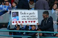 """Young Napoli fans hold a photo of Senegalese defender Kalidou Koulibaly reading """"Although I am small, I'm a man like Koulibaly"""". (AFP Photo/Carlo Hermann)"""