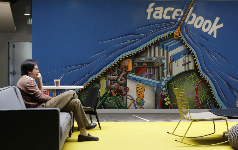 FILE-In this Friday, May 11, 2012, file photo, a worker sits in the Facebook office in Menlo Park, Calif. Silicon Valley, it turns out, doesn't revolve around the stock prices of Facebook and its playful sidekick, Zynga. Instead, the optimism in Silicon Valley can be seen in a variety of ways in this area that covers roughly 40 miles from San Jose to San Francisco. (AP Photo/Jeff Chiu. File)