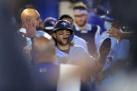 Toronto Blue Jays' Bo Bichette is congratulated after scoring against the New York Yankees during the fourth inning of a baseball game Tuesday, April 13, 2021, in Dunedin, Fla. (AP Photo/Mike Carlson)