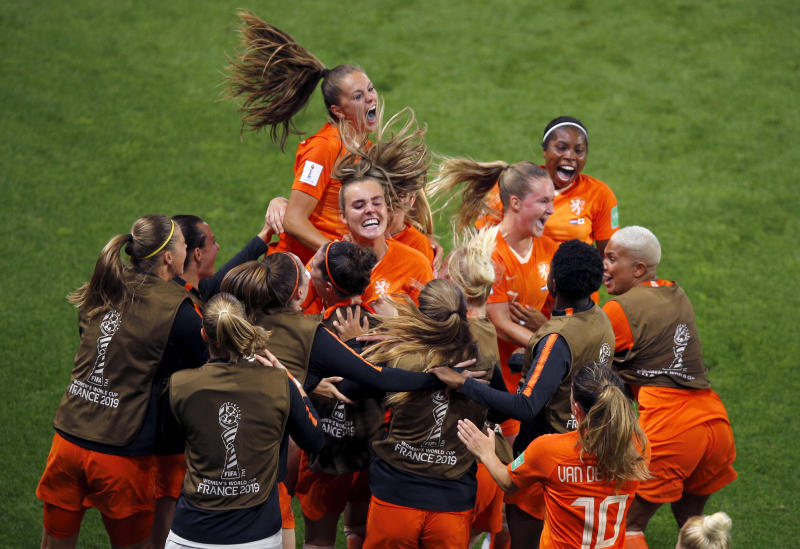 Netherlands' Lieke Martens, top, celebrates with teammates after scoring her team's second goal from the penalty spot during the Women's World Cup round of 16 soccer match between the Netherlands and Japan at Roazhon Park, in Rennes, France, Tuesday, June 25, 2019. (AP Photo/Francois Mori)