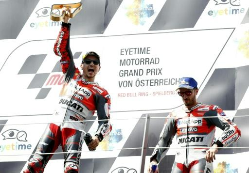 Jorge Lorenzo won a thrilling Austrian MotoGP while Ducati teammate Andrea Dovizioso could only finish third