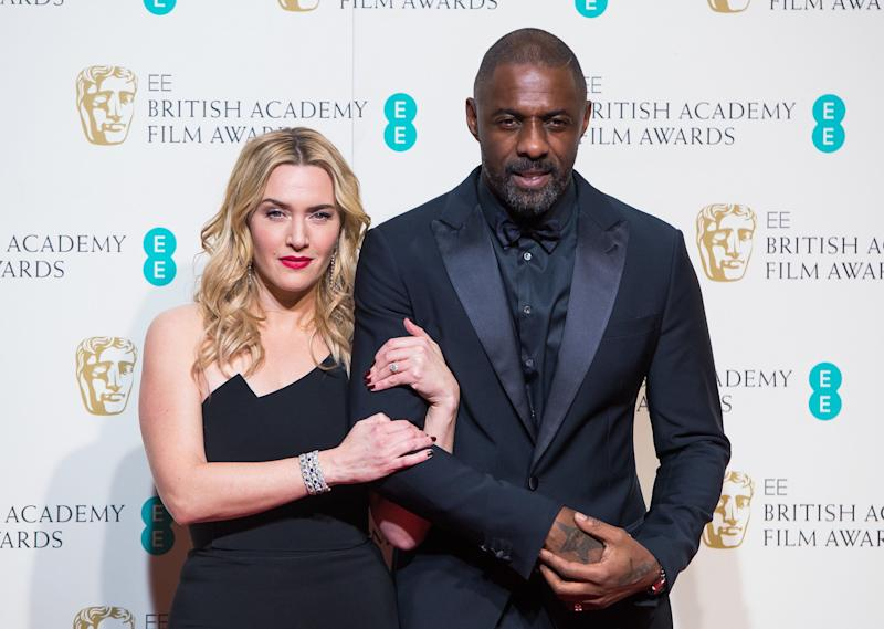 Kate Winslet and Idris Elba pose in the winners room at the EE British Academy Film Awards at The Royal Opera House on Feb. 14, 2016, in London, England.
