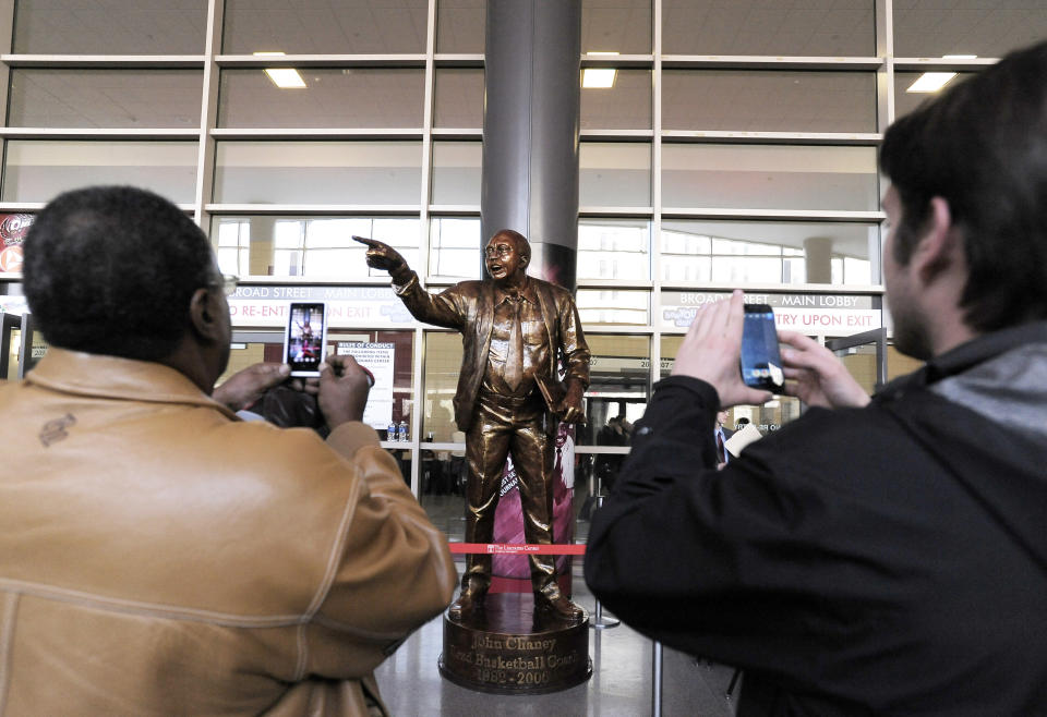 FILE - A statue of former Temple coach John Chaney is unveiled before the start of an NCAA college basketball game against Villanova in Philadelphia, in this Saturday, Feb. 1, 2014, file photo. John Chaney, one of the nations leading Black coaches and a commanding figure during a Hall of Fame basketball career at Temple, has died. He was 89. His death was announced by the university Friday, Jan. 29, 2021.(AP Photo/Michael Perez, File)