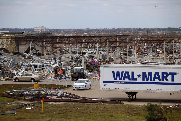 A destroyed Wal Mart is seen in the foreground with Saint John's Hospital in the distance in Joplin, Missouri May 26, 2011. The threat of a new tornado hitting Joplin passed by late on Tuesday. But a line of storms plowed through Oklahoma on Tuesday, where at least five people were killed and many more injured in tornadoes near Oklahoma City. Rescue and recovery teams scoured the wreckage of the small Midwestern city, which was devastated by a high-velocity whirl of wind that destroyed about 2,000 buildings. REUTERS/Eric Thayer (UNITED STATES - Tags: DISASTER ENVIRONMENT)