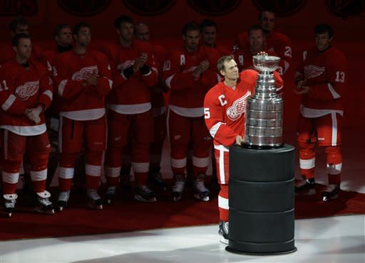 Detroit Red Wings captain Nicklas Lidstrom, of Sweden, holds the Stanley Cup trophy during the teams championship banner-raising prior to their NHL hockey season-opener against the Toronto Maple Leafs in Detroit, Thursday, Oct. 9, 2008. (AP Photo/Paul Sancya)