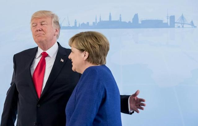 President Donald Trump (L) with German chancellor Angela Merkel.