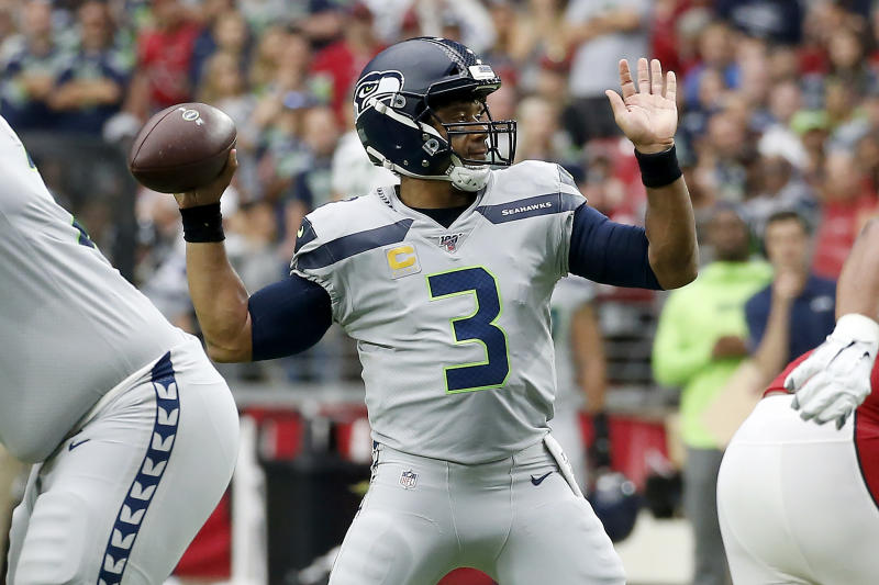 Seattle Seahawks quarterback Russell Wilson (3) throws against the Arizona Cardinals during the first half of an NFL football game, Sunday, Sept. 29, 2019, in Glendale, Ariz. (AP Photo/Ross D. Franklin)